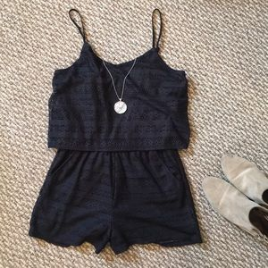 Navy lace romper by Rewind